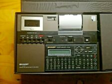 Vintage Sharp PC-1248 Pocket Computer And CE-125 Printer And Micro Tape Cassette