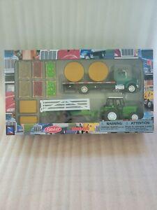 New Ray Green Peterbilt 335 Flat bed Semi Truck w/ Farm Tractor & Trailer & Hay