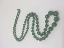Strand of graduated green jade beads, 30 inches long