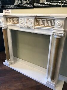 White Marble Roman Style Fireplace with Tan Accents