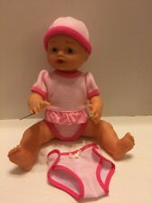 "Lotus Doll Vinyl Girl Baby Giggles Talks Coos Babbles 15"" With Clothing Hat"