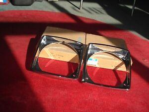NOS 75-76 Oldsmobile Omega  Pair Chrome Headlight bezels 552290 552291