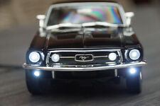 1967 FORD MUSTANG GTA FASTBACK MIT LED-BELEUCHTUNG(XENON) IN 1:18 MAISTO SCHWARZ