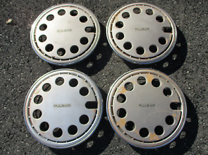 Genuine 1985 to 1986 Nissan Pulsar 13 inch hubcaps wheel covers
