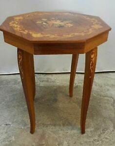 A vintage, brown, wooden table with decorations and music