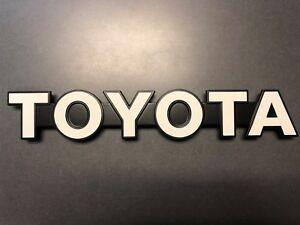Toyota Land Cruiser 1985-1987 BJ70 Front Grille TOYOTA Emblem 75311-90K00