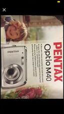 Pentax Optio M40 digital camera And Battery Charger, User Manual And CD Program.