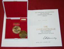 Ehrenmedaille 40 Jahre DDR mit Urkunde an Kurt Ulrich, Bartel Nr.316, Zust. I/II