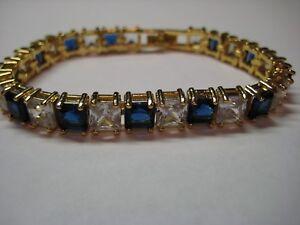Gold Tennis Bracelet with 9.95ctw Blue & White Topaz Gemstones