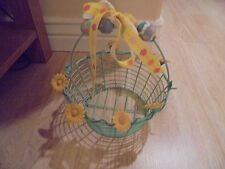 Adorable Wire Home Decorative Easter Basket Surrounded With Metal Daisy Flowers