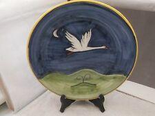 Placa de cerámica decorativo hecho italiano de una Cigüeña Volando? en un cielo nocturno