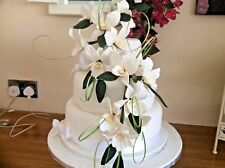 HAND MADE SUGAR ORCHIDS TRAILING TWO SPRAYS IN DARK IVORY,ALSO IN OTHER COLOURS