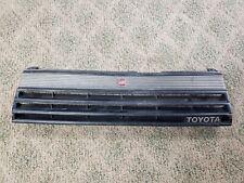 84-85 Toyota Celica Front Upper Grille Emblem 53111-14310 Black OEM *Used