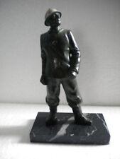 Pompier en régule sur socle marbre