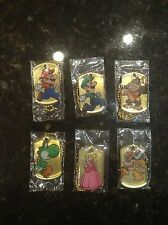 Super Mario Gold Dog tags complete set of 6 mario luigi peach DK toad bowser