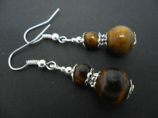 A PAIR OF TIGERS EYE  SILVER  PLATED DROP DANGLY EARRINGS. NEW.