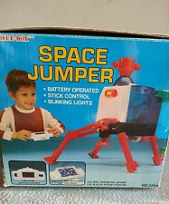 1970's Vintage Blue Box Space Jumper Battery Operated Wired Remote Toy w/ lights