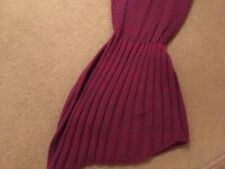 Purple knitted mermaids tail, coast and warm