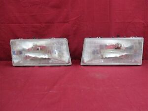 NOS OEM Dodge Spirit Headlamp Light 1989 - 95 PAIR