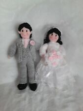 Knitted BRIDE AND GROOM bride white dress, Groom in grey suit pink roses bouquet