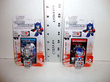 TRANSFORMERS FIGURINES & 3D PUZZLE PIECE COLLECTOR CARD OPTIMUS PRIME & MEGATRON