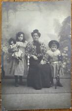 Doll & Little Girl Posing w/Family 1905 Realphoto Postcard