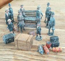 Ten Figures plus sundries. Around 50+ mm high so maybe gauge one. Maybe B.Lowke