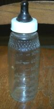 Vintage 1950s Glass Baby Bottle w unusual embossing near top. Includes cap.