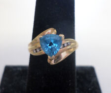 14k yellow gold trillion cut blue topaz and diamonds ring. Size 6.5