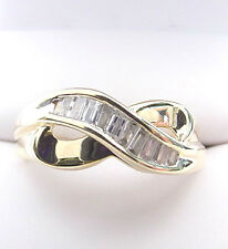BAGUETTE DIAMONDS .25 TCW  WAVE BAND 14K GOLD RING