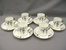 A superb set of six hand painted enamelled Tuscan Coffee Cans & Saucers