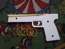 Rubber Band Gun, 5 shots with one load, made from white plastic, safe for kids