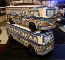 Two 6 1/2� Tin Greyhound Bus