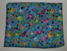fat quarter in cotton poplin with small guitars on black, white and turquoise