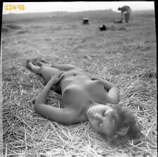 nude girl dreaming on field, vintage fine art negative, 1970's