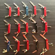 Lot de 15 couteaux d'Officier Suisse  VICTORINOX à restaurer, peu de travail