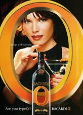 Bacardi O orange print ad 2002 Woman looking through large O