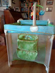 Fisher-Price portable cot, 2 levels with change table and mobile.