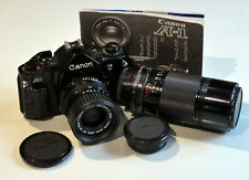 Canon A-1 35mm SLR Film Camera with 2 Canon zoom lenses and manual