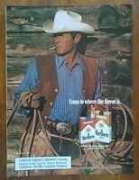 1985 Marlboro Cigarettes Promo Cowboy In Chaps & Lasso Photo Vintage Print Ad
