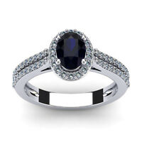 14K WHITE GOLD 1 1/2 CARAT OVAL SHAPE SAPPHIRE AND HALO DIAMOND RING