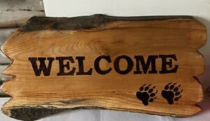 chainsaw carved Welcome Sign and pyrography burnt welcome sign Bear Paws