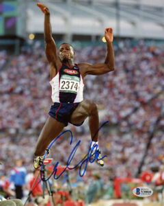 CARL LEWIS SIGNED AUTOGRAPHED 8x10 PHOTO TRACK AND FIELD LEGEND RARE BECKETT BAS