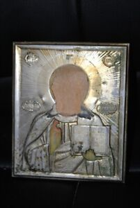 Antique (metal frame) of the icon. On old paper. Torn face.