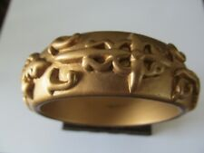 CHUCKY WIDE SATIN GOLD STAINED w/RAISED DESIGNED CELLULOID BANGLE BRACELET