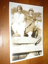 old photo girl in boat with bored companion c1926