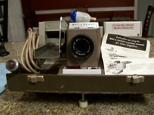 BELL & HOWELL Slide Projector with TDC Electric Changer  Model: Headliner 703