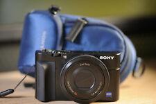 Sony Cyber-shot DSC-RX100 Digital Camera +  ORIGINAL SONY CASE+ GRIP