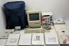 Apple Macintosh Classic with Bag, and Lot's of software & Books. LARGE LOT.