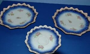 VINTAGE TABLEWARE TWO PINK EDGED PLATES AND ONE PINK EDGED SAUCER